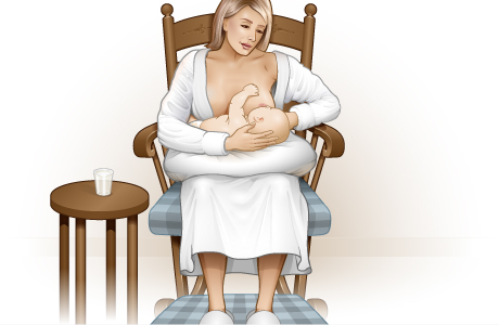 Woman in chair holding her baby in her lap