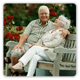 Photo of older married couple sitting on bench