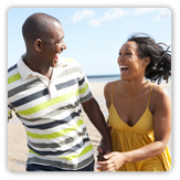 Photo of woman and man walking on the beach