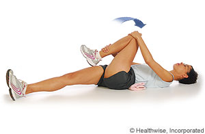 A woman stretching piriformis muscle