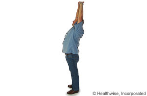 Picture of a standing overhead stretch to ease back fatigue