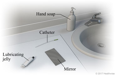 Bathroom sink area, showing supplies of hand soap, catheter, lubricating jelly, and mirror.