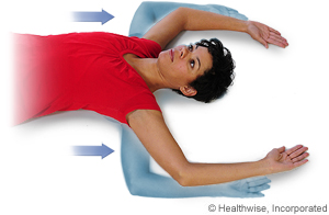 Picture of chest stretch exercise while lying down