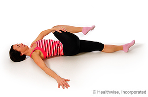 Photo of piriformis stretch while lying down