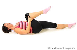 Photo of knee-to-chest stretch